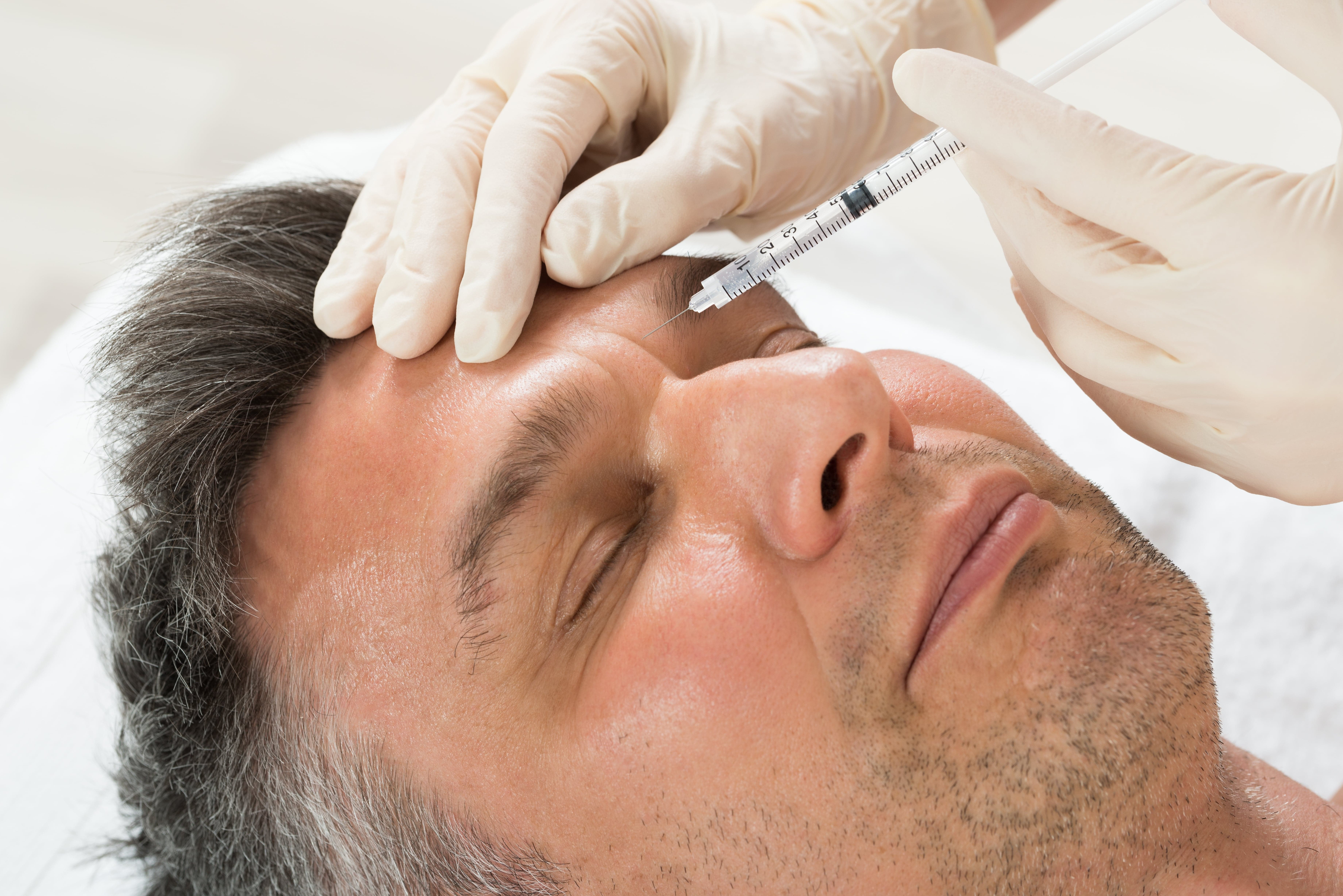 Botox on Mans forehead lying down, Costmetic Treatment, Cutting Edge Aesthetics, East Sussex