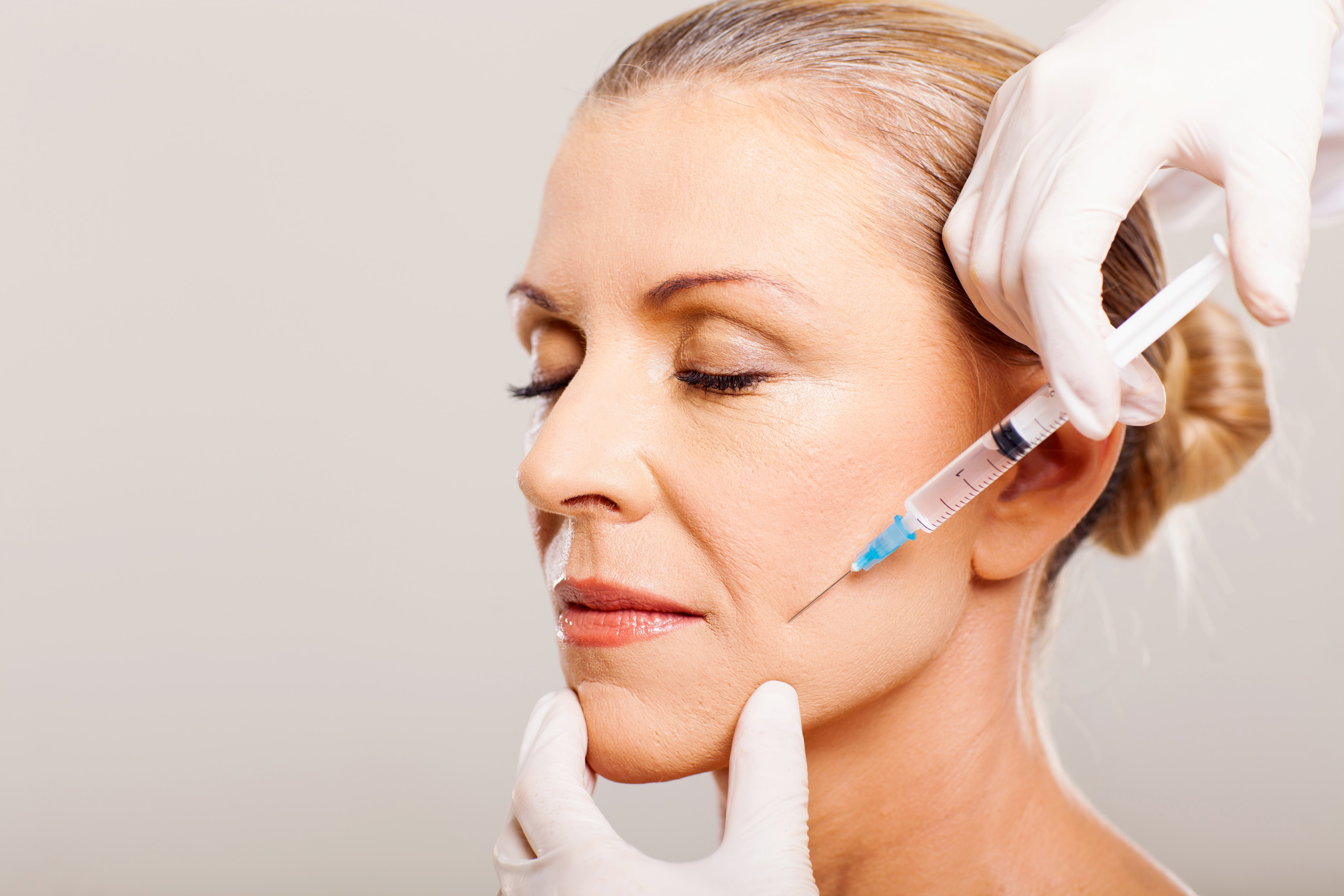 Woman's face, injection for facial wrinkles treatment, Cosmetic Treatment, Cutting Edge Aesthetics, East Sussex